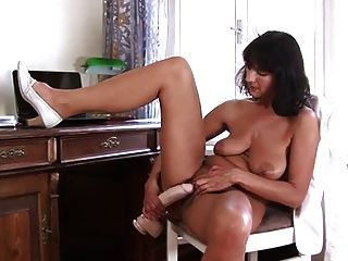 Sexy Mature Stuff Her Pussy With A Big Dildo