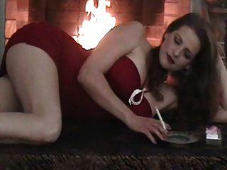 Hot Babe In Red Smoking