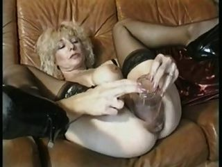 Granny Inserts Big Dildo